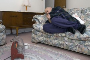 elderly man on sofa